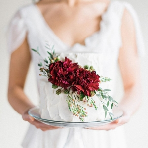 Delicate Wedding Cake with a Rich Burgundy Floral Topper