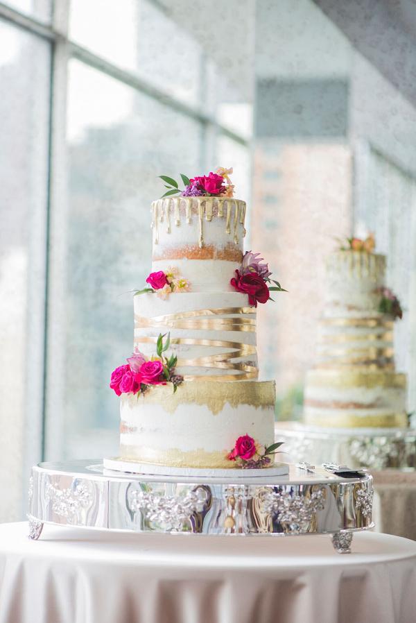 Modern Metallic Gold Wedding Cake with Bold Pink Flowers