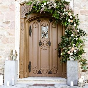 Elegant Floral Garland and Metallic Lanterns