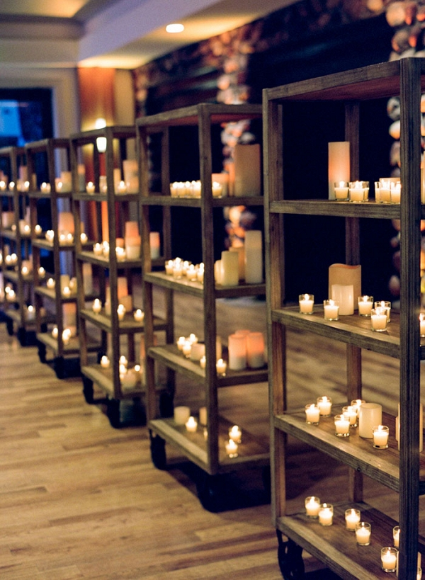 Banks of Shelves with Glowing Candles