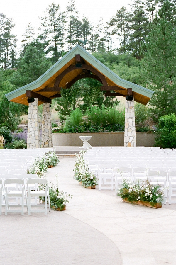 Elegant Mountain Wedding Ceremony with Wildflower Aisle Decor