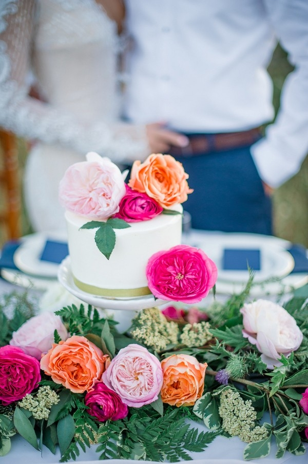 One Tier Wedding Cake Topped with Colorful Flowers!
