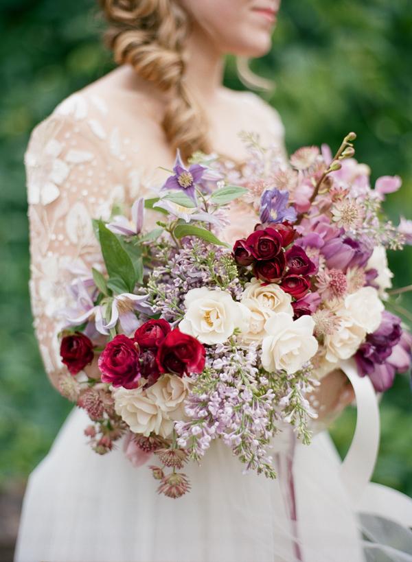 Beaded Long Sleeve Wedding Dress with a Modern Purple Bouquet