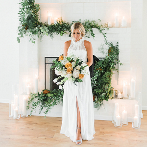 Modern White Brick Fireplace Altar with a Greenery Garland