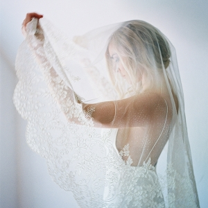 Bride in a Romantic Lace Trimmed Veil