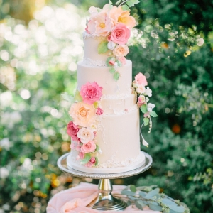 Garden Wedding Cake in Pastel Shades of Peach, Yellow, and Pink