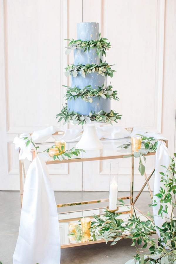Marbled Wedding Cake with Greenery Garlands Between Layers