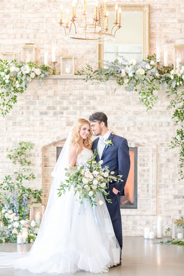 Stone Fireplace with Greenery and Spring Flowers for a Ceremony Altar