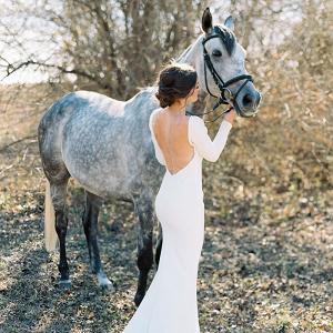 Horse Loving Brie with a Low Back Long Sleeve Wedding Dress