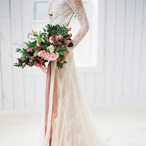 Dramatic Lace Wedding Dress with a Blackberry Bouquet