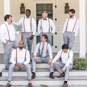 Rustic Groomsmen in Suspenders and Bow Ties