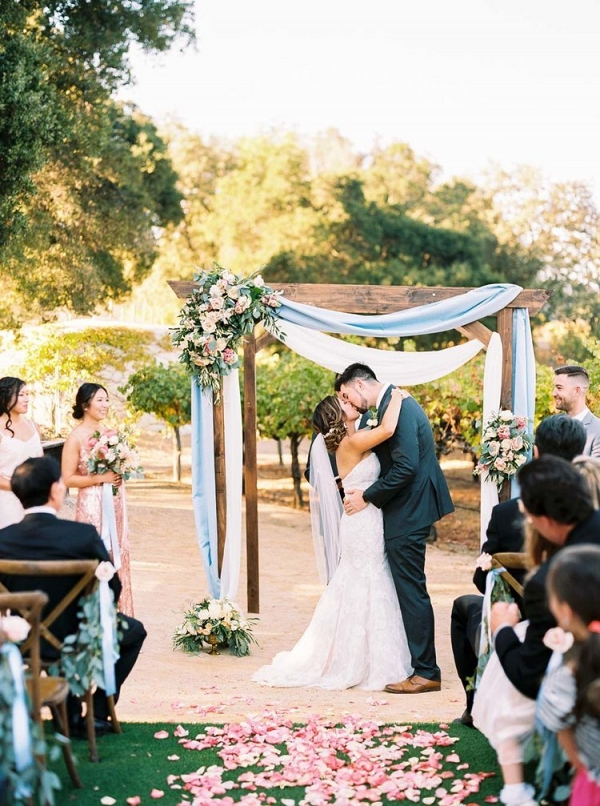 Vineyard Wedding Ceremony Decor with Drapery and Summer Flowers