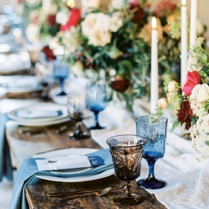 Elegant Rustic Tablescape in Rich Blue, White, and Red