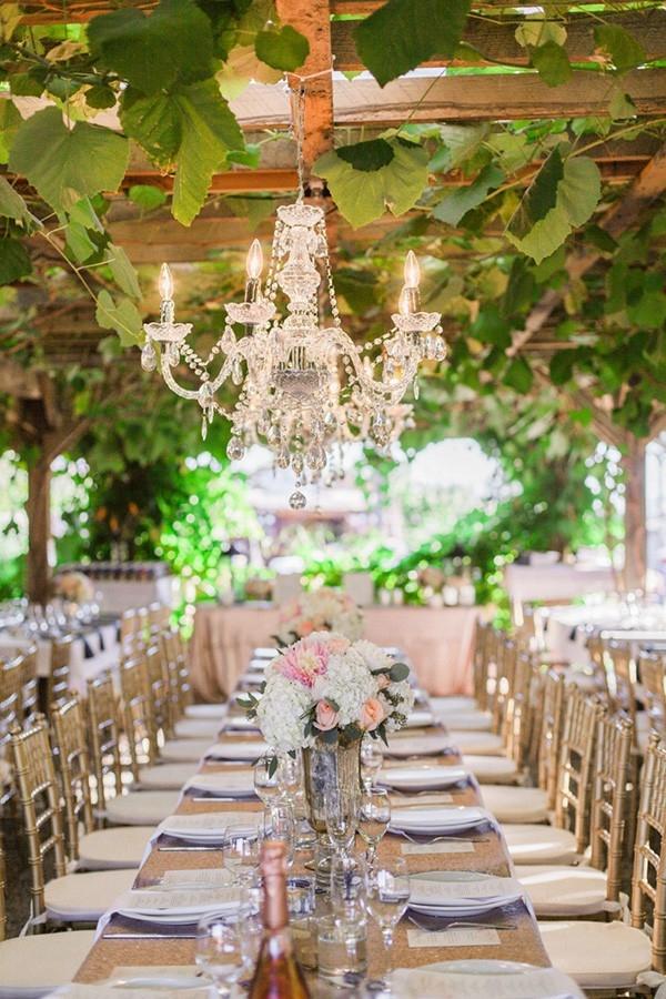 Sparkling Reception Tables under a Crystal Chandelier
