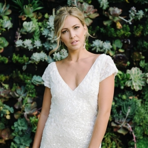 Stunning Sparkling Wedding Dress against a Succulent Wall