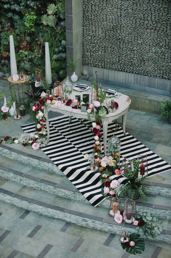 Sweetheart Table with Black and White Stripes and a Floral Runner with Geometric Lanterns