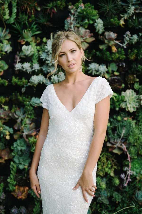 Stunning Sparkling Wedding Dress against a Succulent Wall