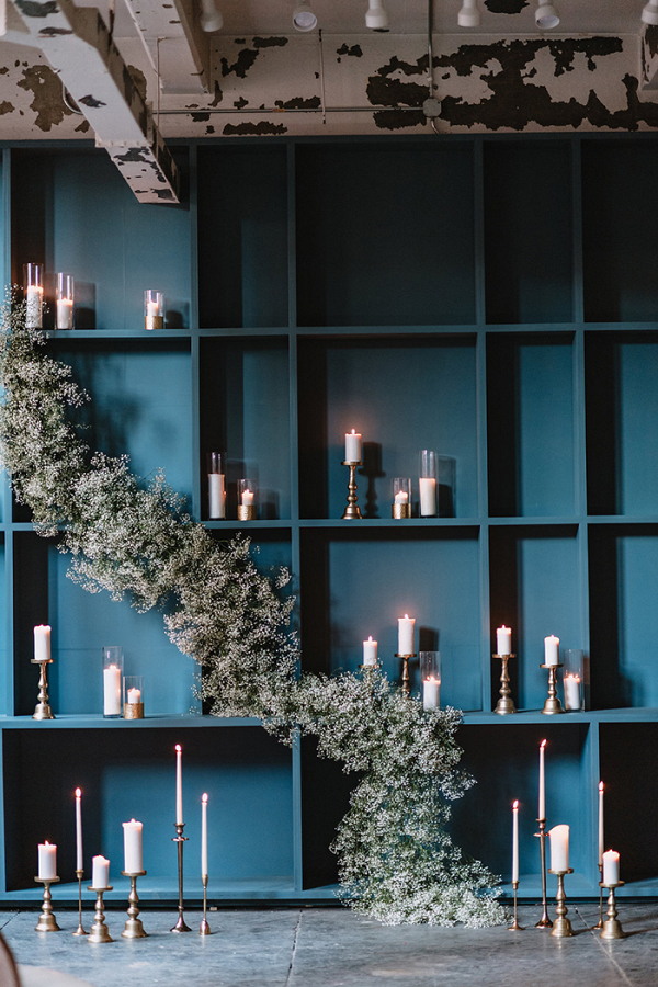 Modern Ceremony Decor with a Floral Garland and Candles