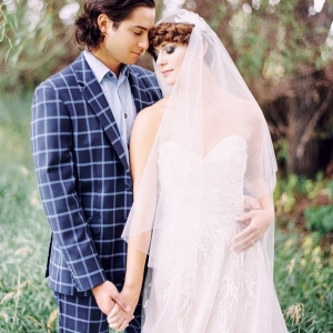 Modern Bride and Groom with a Blush Wedding Dress and a Patterned Suit
