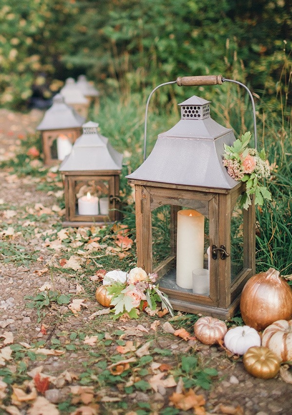 Metallic Pumpkins and Candle Lanterns Lining the Aisle
