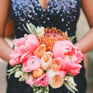 Navy Sequin Bridesmaid Dress with a Coral Peony Bouquet