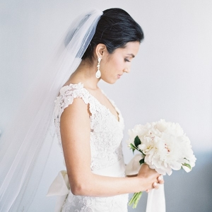 Romantic Veiled Bridal Portrait with a White Peony Bouquet