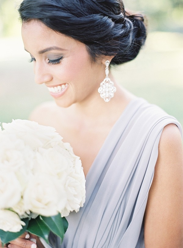 Bridesmaid in Lilac Gray with Statement Earrings and a White Rose Bouquet