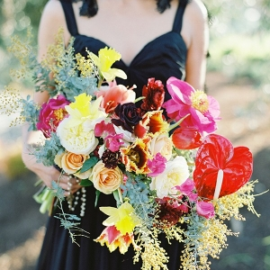 Vibrant Yellow and Pink Bouquet with a Black Wedding Dress