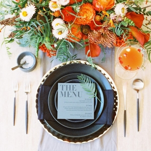 Modern Black and Orange Place Setting with a Specialty Cocktail