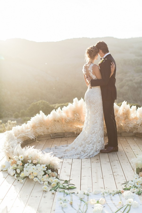 Bride and Groom in a Floral Altar Circle at Magic Hour