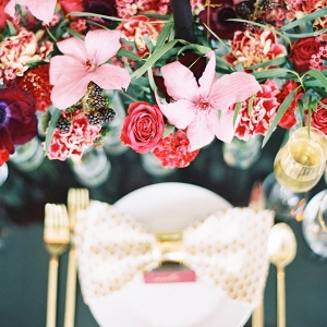 Gold Patterned Place Setting with a Colorful Floral Runner