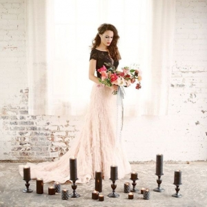 Dramatic Bride in Black and Blush Surrounded by Candles