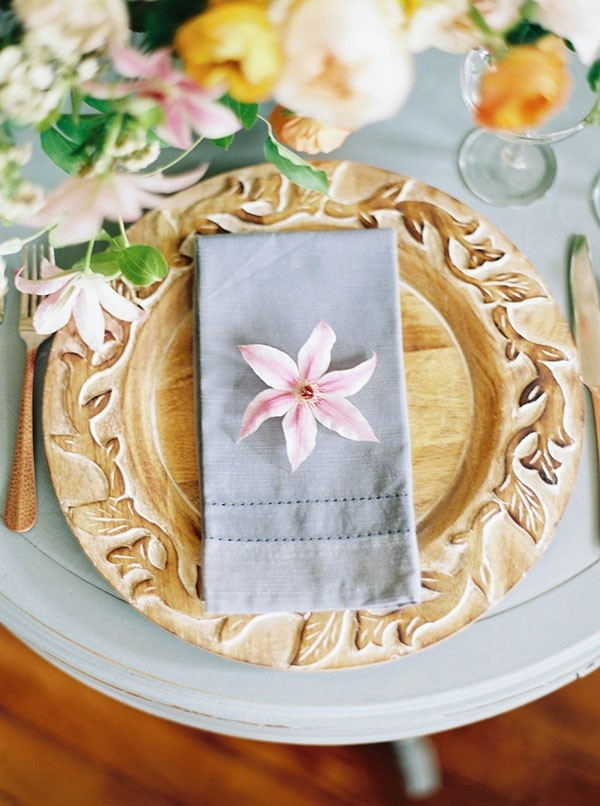 Place Setting with a Carved Wooden Charger and Spring Flowers