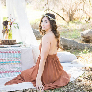 Boho-Picnic-Anniversary-Session-wife-in-brown-dress