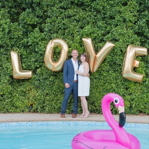 Intimate Palm Springs Destination Wedding - love letter balloons with pink flamingo