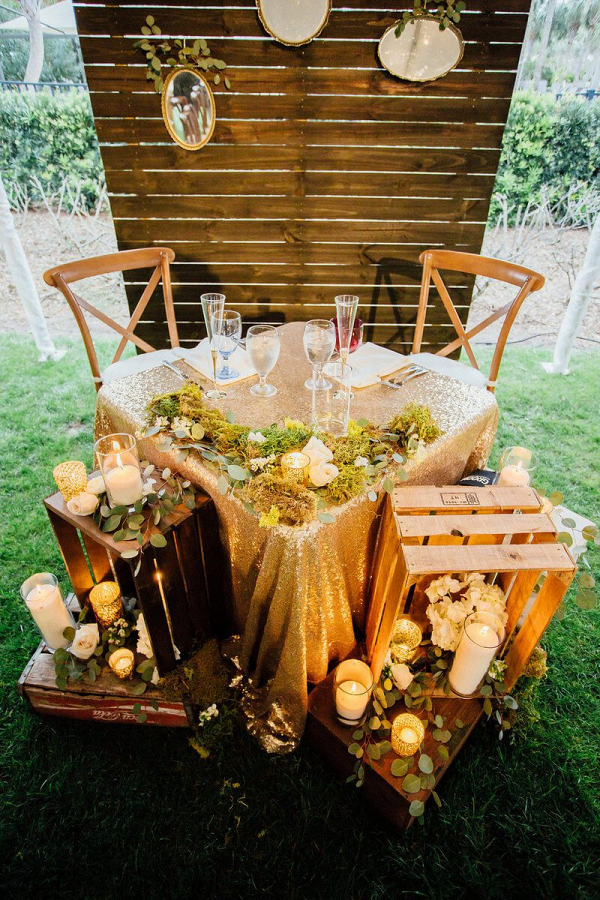 Outdoor-Shabby-Chic-Wedding-sweethert-table-with-gold-sequin-linen