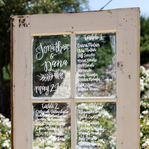 Tuscan-Inspired-Wedding-wooden-glass-door-seating-chart