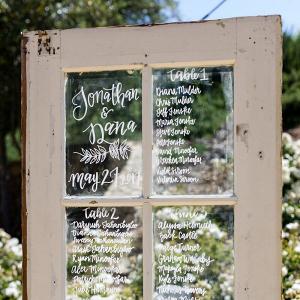 Tuscan-Inspired-Wedding-wooden-glass-door-seating-chart