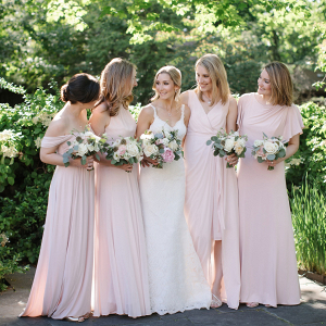 Bridesmaids in long blush dresses
