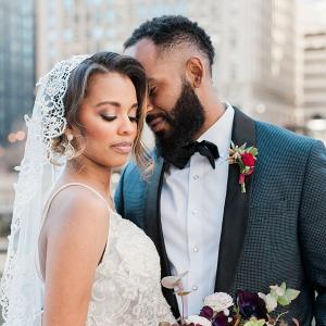 Bride with mantilla veil with groom in navy suit