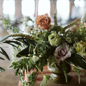Wild greenery and rose centerpieces