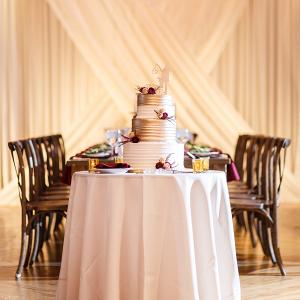 Metallic wedding cake with fresh flowers