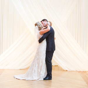Wedding couple with dramatic draping backdrop