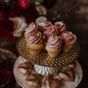 Pink cupcakes with gold leaf