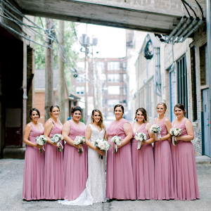 Bridesmaids in long mauve dresses