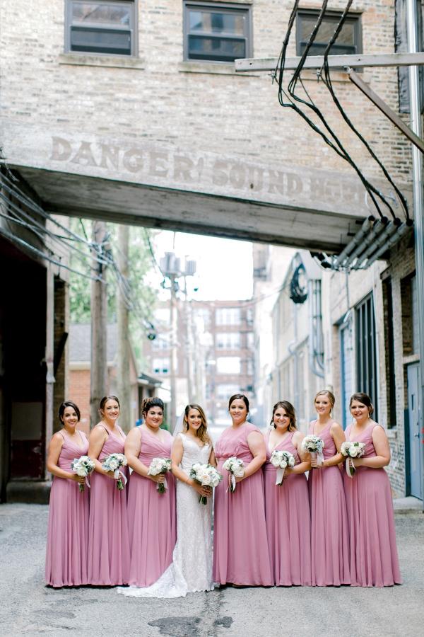 Bridesmaids in long mauve dresses