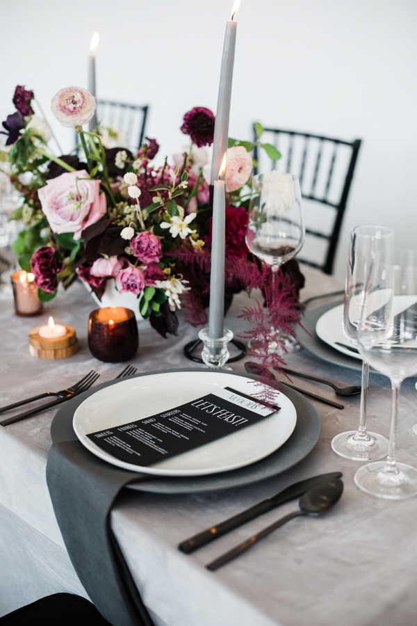 Purple and black wedding tablescape