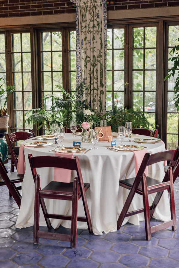 Mansion wedding reception with handmade table numbers