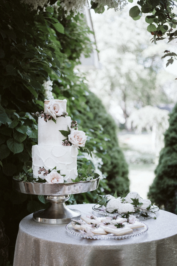 Romantic buttercream wedding cake with fresh florals