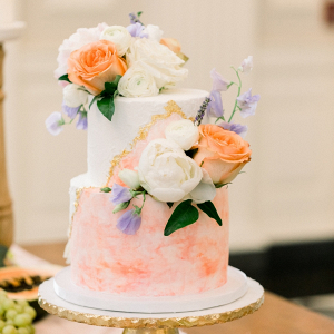 Peach watercolor geode wedding cake